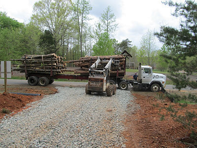 8 – Skid loading logs at curb side to reduce sediment from leaving the site